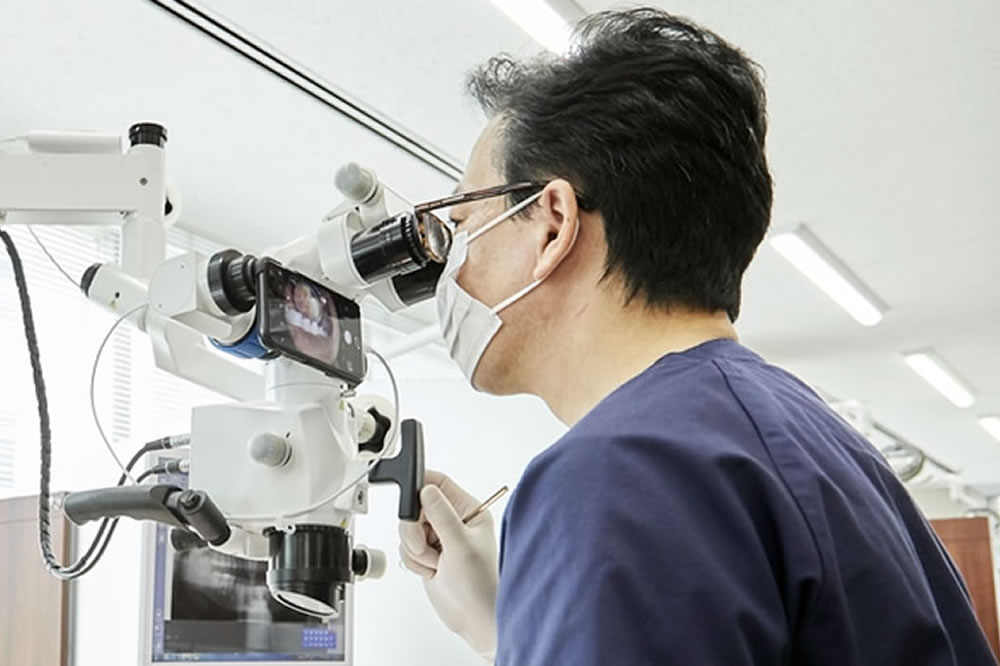 顕微鏡使用の精密治療